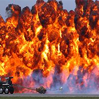Mastered pyrotechnics, slow pyrotechnic inflator
